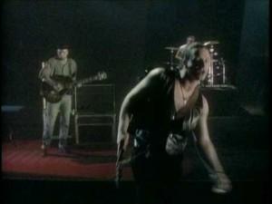 Bono holsters his guitar.