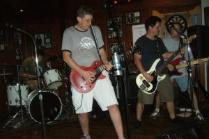 Not my friend's old band, but just as guilty of showing calves and knees onstage.
