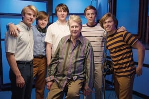 Dennis Leary (far right) as Dennis Wilson.