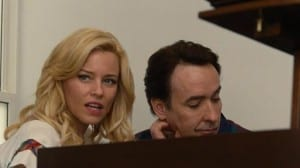 "Brian plays Melinda his early sketch of ""Lick My Love Pump."""